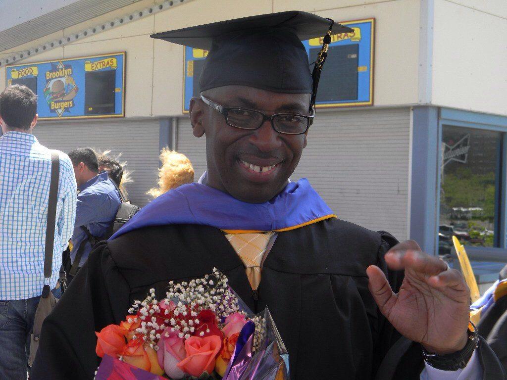 A man wearing graduation garments