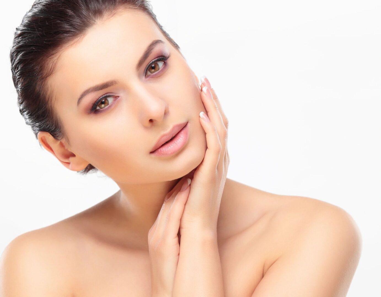 A beautiful woman touching her face
