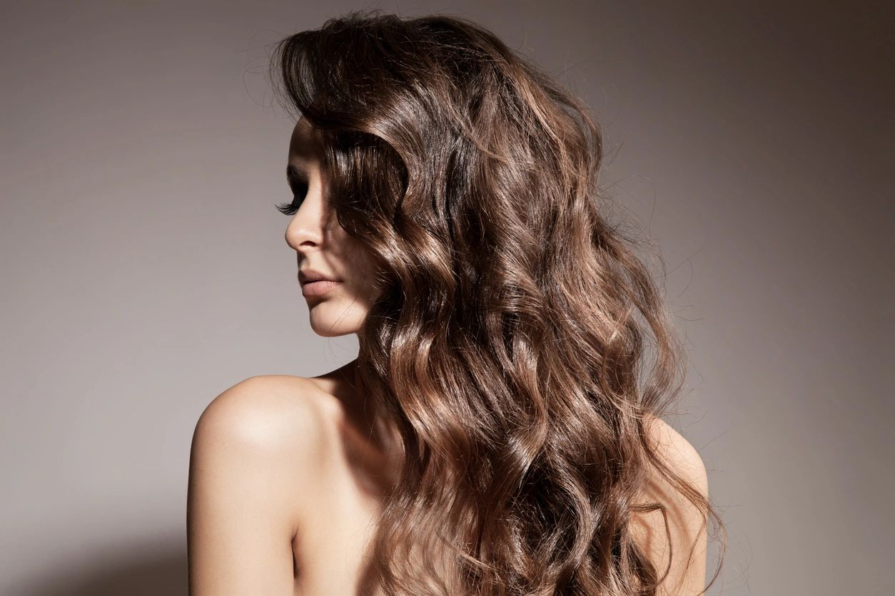 A woman with curled dark brown hair