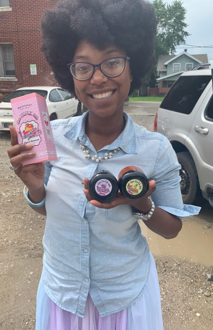 A woman posing for a picture with our products